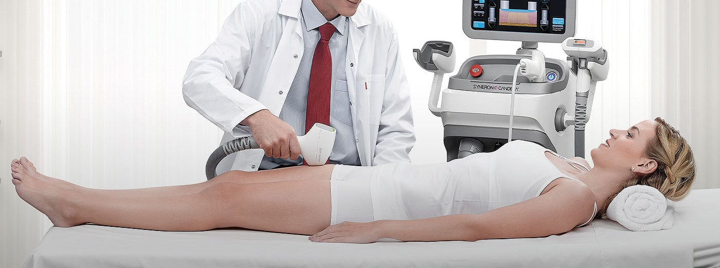 practitioner performing elos laser treatment on woman patient lying on table